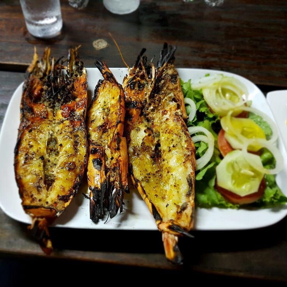 Tiger prawns prepared over a fire with lemon butter and garlic in Beira Mozambique