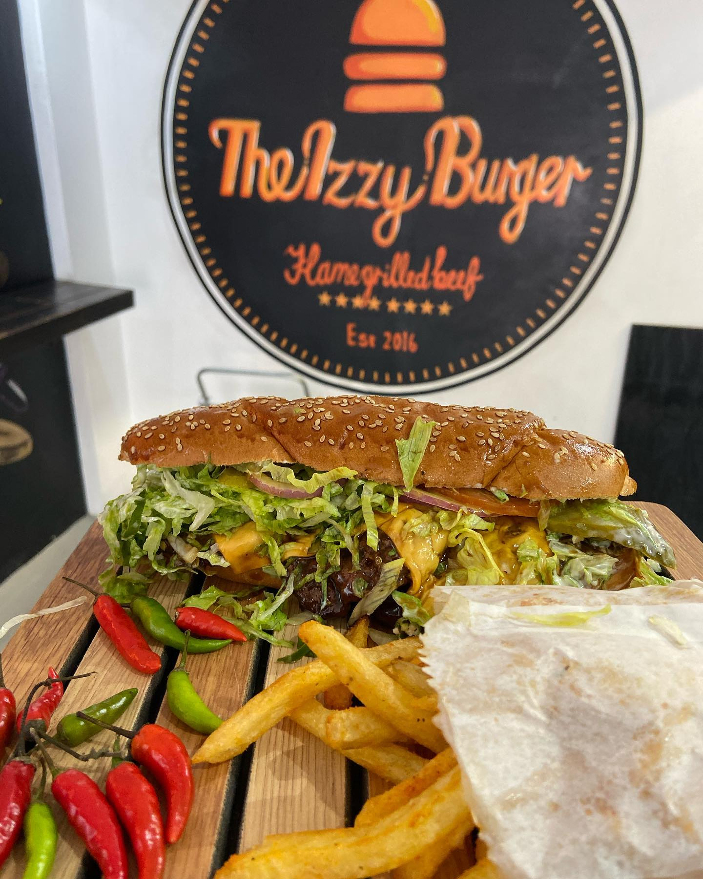 Finally had @theizzyburger in Wynberg,Cape Town. We had the Izzy Long and a Single Izzy. The fries are ️. The sauce and pattie are ️. The Izzy Long is 3 100g patties in a long roll with cheese,chilli and garnish. Great Shout #halaal